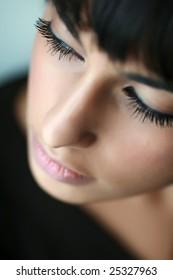 Portrait of east girl. Sharpness on eyelashes.