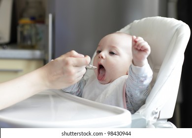 Portrait of eating baby boy at home