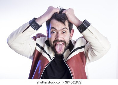 Portrait of eccentric crazy man pulling his hair and making funny gestures