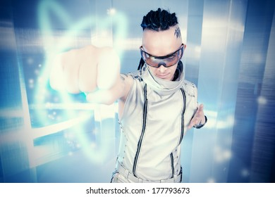 Portrait of the eccentric futuristic man in silver costume. Innovations and high technology. Rock artist.