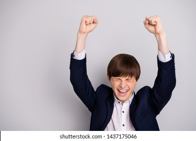 Portrait of ecstatic funny funky lovely pupil raise fists scream shout yeah have aim triumph lesson learning wear shirt white black blazers jacket isolated grey silver background