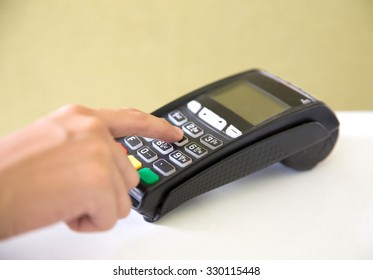 A portrait of EDC ( electronic Data Capture) machine, hand pressing password on it