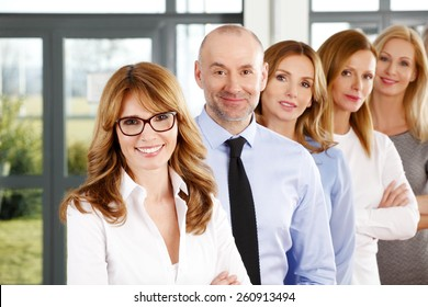 Portrait of efficiency business people standing in a row at office.