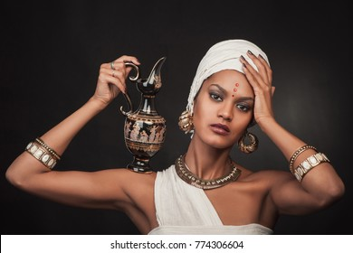 Portrait of egypt woman on dark background