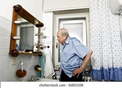 portrait of elder man in the bathroom
