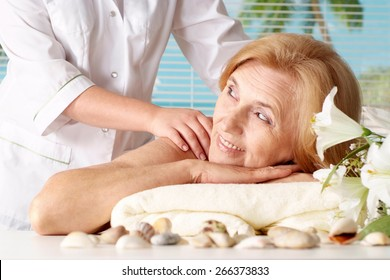 Portrait of an elder woman at the spa