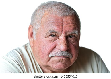 portrait of an elderly caucasian gentleman. Gray-haired old man with a mustache looking at the camera. isolated on whine