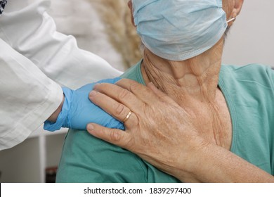 Portrait of elderly caucasian woman wearing protective medical mask. Care for the elderly people during corona virus outbreak, a helping hand, home care concept.