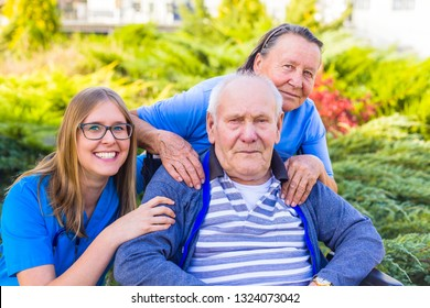 Portrait of elderly couple and doctor at elderly home park.