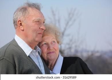 Portrait of elderly couple on spring sky