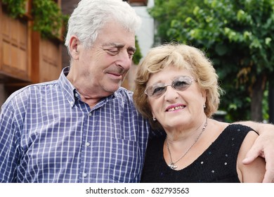 Portrait of an elderly couple at the street. Outdoors.