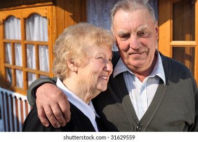 Portrait of elderly couple in yard