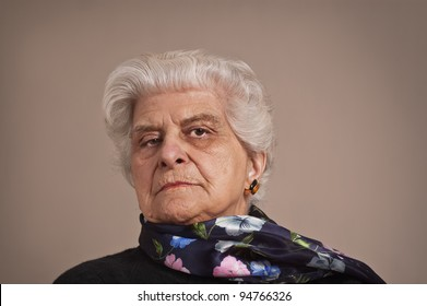 A portrait of an elderly lady dressed in black,  with copy space.