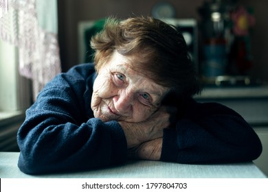 Portrait of an elderly lady in her home.