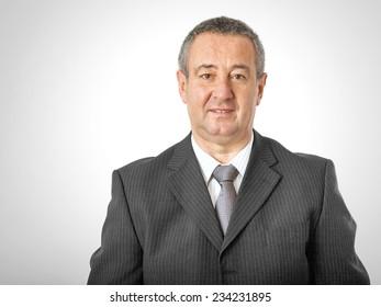 Portrait of elderly man in elegant suit