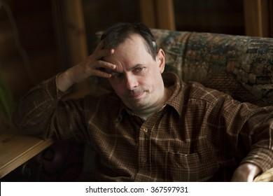 portrait of the elderly man in an interior
