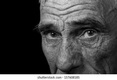 portrait of an elderly man on black background