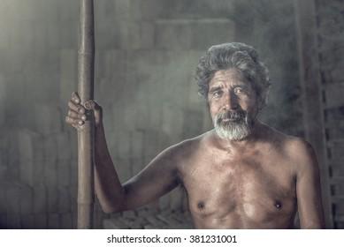 portrait of an elderly man on black background