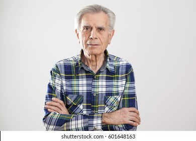 Portrait elderly man on gray background