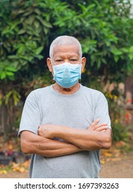 Portrait of elderly man with short white hair and wearing face mask for healthy because have air pollution PM 2.5. Mask for protect virus, coronavirus, bacteria, pollen grains. Healthcare concept