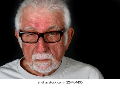 Portrait of an elderly man showing a sad expression with a tear coming down his cheek