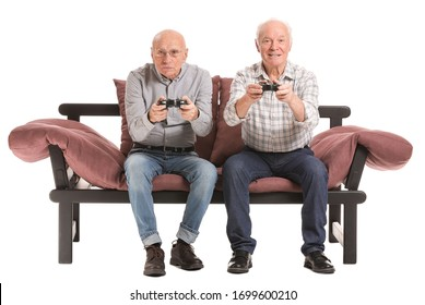 Portrait of elderly men playing video games on white background