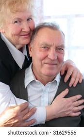 Portrait of elderly pair looking at camera