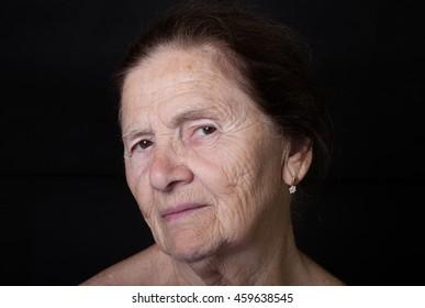 Portrait of elderly woman. Attentiveness.