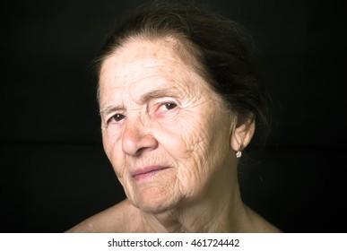 Portrait of elderly woman. Attentiveness. Toned.