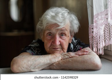 Portrait of an elderly woman close-up.