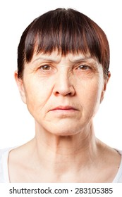 portrait of an elderly woman with dark hair . Brown eyes. deep wrinkles on the face