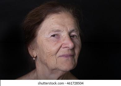 Portrait of elderly woman. Dreaminess.