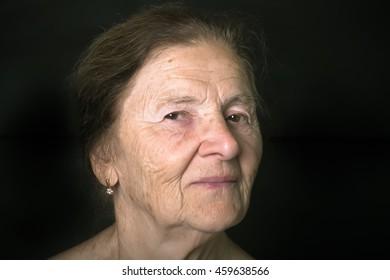 Portrait of elderly woman. Dreaminess. Toned.