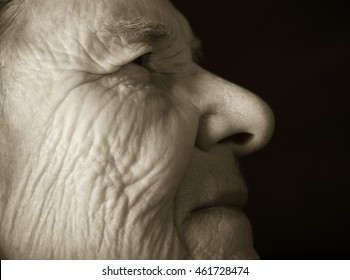 Portrait of elderly woman. Dreaminess. Toned.