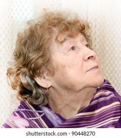 portrait of elderly woman dreaming