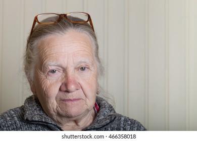 Portrait of elderly woman in glasses.