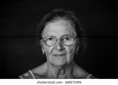 Portrait of elderly woman in a glasses. Toned.