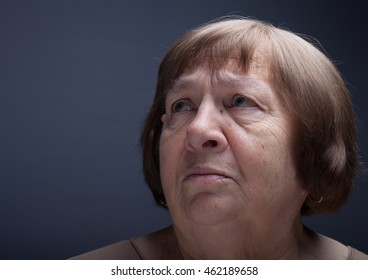 Portrait of elderly woman. Grievance.