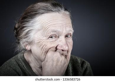 Portrait of elderly woman. Grin. Toned.