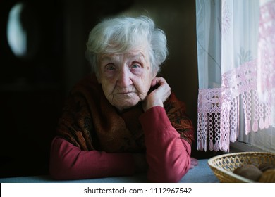 Portrait of an elderly woman in her house. Сare of seniors.