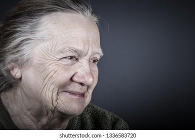 Portrait of elderly woman. Laugh. Toned.