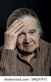 Portrait of elderly woman on dark background.