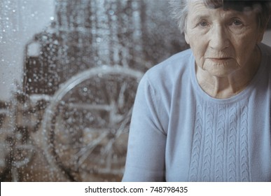 Portrait of elderly woman with osteoporosis waiting for caregiver