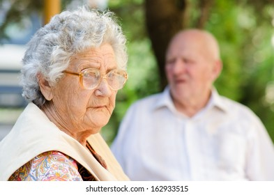 Portrait of the elderly woman. Outdoors
