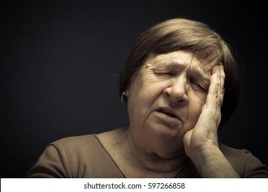 Portrait of elderly woman. Pain. Toned.