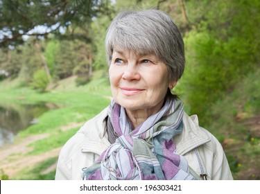 portrait of elderly woman in the park