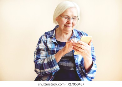 Portrait of an elderly woman with phone