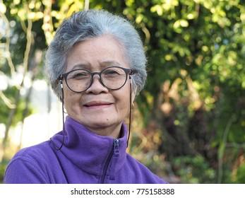 Portrait of a elderly woman smile in the garden.