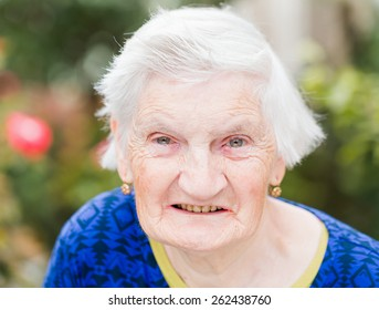 Portrait of elderly woman smiling at the camera