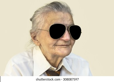 Portrait of elderly woman with sunglasses. Selective focus.